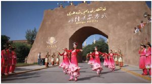 A Kashgar welcoming ceremony featured dancers in ethnic dress in front of the gates of the old city. (Photo: Ülle Baum)