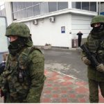 "Unidentified gunmen, known at the time as ""little green men"" were on patrol at Simferopol Airport in Ukraine's Crimea peninsula in February 2014. (Photo: Elizabeth Arrott / VOA)"
