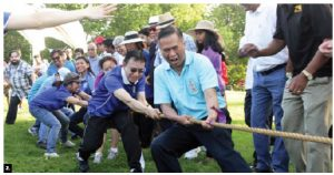 The High Commission of Malaysia hosted the 2016 ASEAN picnic at Vincent Massey Park. Heads of mission, staff and their families took part. Here, Thai Ambassador Vijavat Isarabhakdi leads his team in a tug-of-war. (Photo: Sam Garcia)