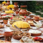 Traditional Moldovan dishes: Mamaliga (corn bread), placinte (vegetable stuffed pie), friptura (traditional pork stew), grilled vegetables and pickles. (Photo: Maxim Chumash)