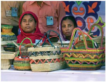 According to the World Bank, 1.9 billion people — 37.1 per cent of the global population — lived on less than $1.90 a day in 1990. By 2015, that number was down to 702 million — 9.6 per cent of global population. These businesswomen are beneficiaries of the Grameen Bank project for poverty eradication. (Photo: UN photo)