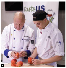 U.S. Ambassador Bruce Heyman visited Algonquin College to promote American produce. He's shown here cooking with student Tomas Ferraton. (Photo: Jana Chytilova)