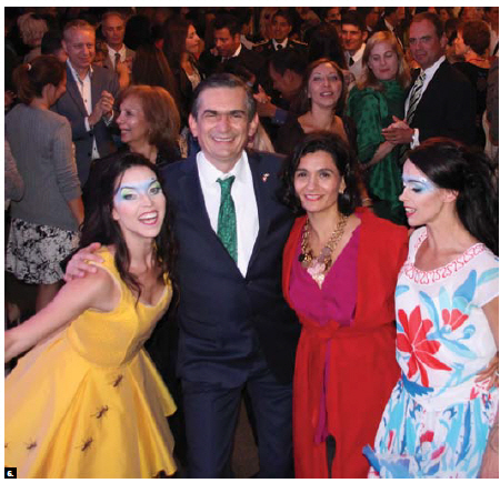 To mark the 206th anniversary of the independence of Mexico, Ambassador Agustín García López, centre left, and his wife, Katya Anaya de García-Lopez, centre right, hosted a reception at their residence. They're shown with Cirque du Soleil acrobats, who attended the event. (Photo: Ülle Baum)
