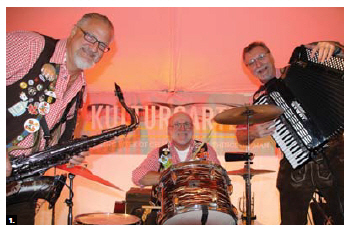 The Kitchener band Twin City Alpine Echo performed at a Bierfest hosted by German Ambassador Werner Wnendt and his wife, Eleonore Wnendt-Juber. Guests enjoyed premium German beer. From left, John (Hansi) Kroisenbrunner, Murray Giilck and Alf Schroth. (Photo by Ülle Baum)
