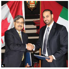 The Emirates Postal Group and Canada Post Corporation signed a bilateral agreement at the embassy of the United Arab Emirates. From left, Deepak Chopra, president and CEO of Canada Post, and Abdullah Al Ashram, CEO of Emirates Post. (Photo by Ülle Baum)