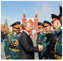 "Russian President Vladimir Putin, shown here greeting members of his military, has established an ""authoritarian, expansionist state."" (Photo: presidential press and information office of russia)"