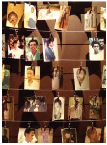 Photographs of genocide survivors hang in the Rwandan memorial centre. (Photo:  Adam Jones)