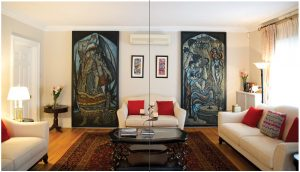 Art in the spacious living room includes two large paintings by the late acclaimed Pakistani artist Sadequain. Between the two paintings hang framed samples of calligraphy. (Photo: Ashley Fraser)