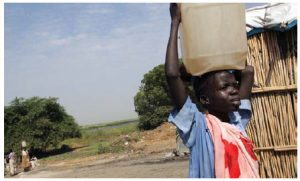 Children across Africa are forced to carry water on their heads over long distances every day, often at the expense of missing school. (Photo: UN)