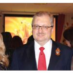 Tamilya Akhmetzhanova, left, Russian Ambassador Alexander Darchiev and Elizabeth Aubin, right, chargé d'affaires at the U.S. embassy, took part in Victory Day celebrations.