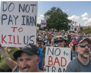 A landmark nuclear non-proliferation treaty regime dates back to 1968. It has slowed the spread of nuclear weapon states, but it has not brought proliferation to a standstill. The protest pictured above took place in Washington, D.C.