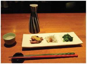 The small portions at izakaya allow you to try many different tastes with various kinds of sake. (Photo: Kenjiro Monji)