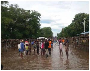 Haitians gather at a flooded market after hurricanes ravaged Ouanaminthe in northeast Haiti in 2017. Climate change is an even more serious concern in Latin America. (Photo: Josiah Cherenfant, VOA Creole Service)