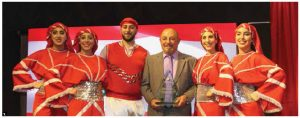 The Al-Arz Lebanese Art Group, a North American Lebanese dance group, participated at Ottawa Welcomes the World festivities during the Lebanese national day reception at Lansdowne Park's Horticulture Building. Dancers are shown with Tony Yazbek, founder and leader of the group. (Photo: Ülle Baum)