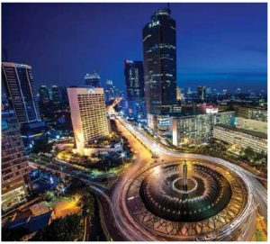 "An aerial view of the Bundaran Hotel Indonesia, in Jakarta. At the centre of the roundabout, surrounded by a water fountain, is the Selamat Datang ""welcome"" Monument. Every Sunday morning during Car-Free Days, the roundabout fills with people jogging, cycling and walking. (Photo: www.wallpapers.com)"
