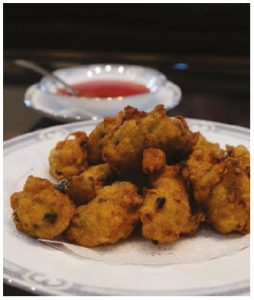 These shrimp fritters are served with a sweet and spicy chili sauce. (Photo: Dyanne Wilson)