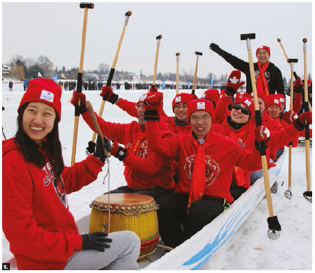 """The Chinese Embassy and Global Affairs Canada entered their """"Polar panda"""" team in Winterlude's second annual Ice Dragon Boat race. Chinese Ambassador Shaye Lu (centre right) took part in the competition. (Photo: Ülle Baum)"""