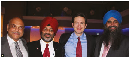 Four hundred people attended a dinner and dance put on by the Indo-Canada Ottawa Business Chamber (ICOBC) at the Infinity Convention Centre in support of mental health. From left: Biju George, CEO of Caneast Films; Jagdeep Perhar, president of ICOBC; MP Pierre Poilievre and former MP Tim Uppal. (Photo: Ülle Baum)