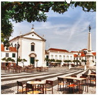 The Algarve region, whose southern tip lies three hours south of Lisbon, also offers dolphin-watchng. The town square is shown here. (Photo: Bert Kaufmann)