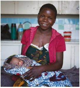 Zaituni and her baby, Mariam, in the post-natal ward at Kiomboi Hospital, Iramba, Tanzania. The mother almost died in childbirth from post-birth sepsis likely caused by washing in dirty pond water. (Photo: WaterAid, Anna Kari)