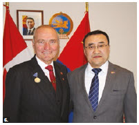 Senator Joseph Day received the Mongolian Presidential Friendship Medal for chairing the Canada-Mongolia Parliamentary Friendship Group. From left: Day and Bayanbat Bayasgalan, counsellor and chargé d'affaires. (Photo: Ülle Baum)