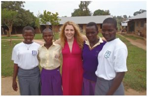 From left, Aninga Project students Aninga, Adania, Aninga Project founder Jenny Benson, and students Scovia and Viola. Since completing her studies, Aninga is now working as a community development officer and Viola is working as a secondary school teacher.  (Photo: The aninga project)