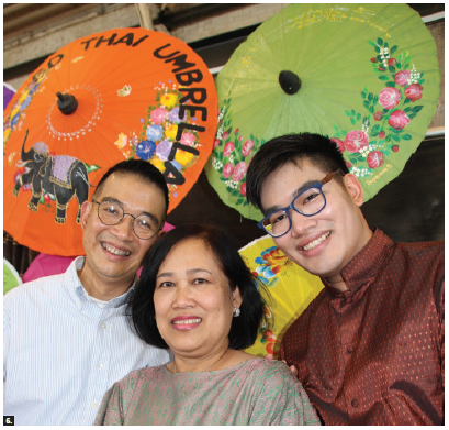 The Amazing Thailand Festival, held at the Horticulture Building of Lansdowne Park, featured cultural shows, handicrafts and food. From left: Thai Ambassador Maris Sangiampongsa, his wife, Kokan, and son, Chain, with colourful Thai umbrellas. (Photo: Ülle Baum)
