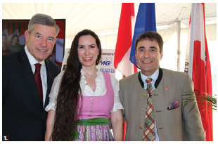 To celebrate Austria's centenary, Ambassador Stefan Pehringer and his wife, Debra Jean, hosted a recep[tion at their residence. From left: Grant J. McDonald, managing partner, KPMG LLP, and the Pehringers. (Photo: Ülle Baum)