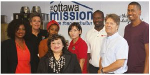 Staff from the South African High Commission help out at The Ottawa Mission. From left, South African High Commissioner Sibongiseni Dlamini-Mntambo, social secretary Trudi Hogue, third secretary Nondlela Maponya, receptionist Lea Allen, accountant Julia Shin, administrative clerk Lunga Majombozi, The Ottawa Mission's executive director Peter Tilley and first secretary Fernando Slawers.