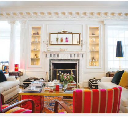 As its central element, the drawing room features a Carrara marble fireplace, ornate cornices and pops of colour in the furniture.  (Photo: Ashley Fraser)