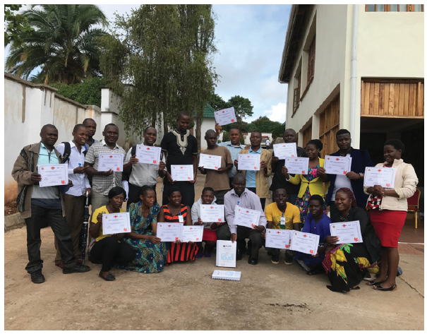 Participants from Mzuzu, Malawi, hold their certificates of completion of the ALARM International Program (AIP), run by the Ottawa-based Society of Obstetricians and Gynecologists of Canada. (Photo: SOGC)