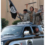 ISIS fighters entering Raqqa, Syria, in 2014. (Photo: Denarivs)