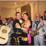 The Ottawa Service Attachés Association hosted annual international cuisine night at the Sala San Marco Conference Centre. More than 600 people attended the event and 18 countries participated. At centre, Lt.-Col. Pedro J. Ornelas Cruz, defence attaché of Mexico, and his wife, Natalia, dance to the music of a mariachi band. (Photo: Ülle Baum)