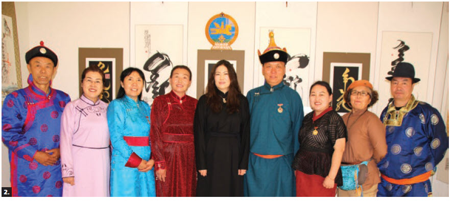 A week-long international exhibition of Mongolian calligraphy took place at the Embassy of Mongolia. A group of participating Mongolian artists in national costumes stand in front of their artwork. (Photo: Ülle Baum)