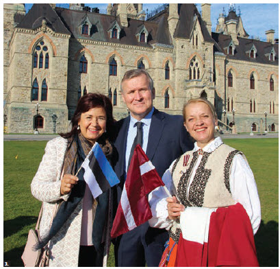 The annual Baltic Unity Day took place on Parliament Hill. Estonian Ambassador Toomas Lukk is flanked by his wife, Piret Lukk, and Inara Eihenbauma, wife of the Latvian ambassador Karlis Eihenbaums. (Photo: Ülle Baum)