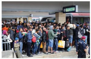 The migration crisis in Europe is about a lack of function in border control and the fact that those in the EU don't agree on joint principles of what migration and refugee status are. Shown here are Iraqi and Syrian migrants at the Vienna railway station in 2015. (Photo: Bwag)