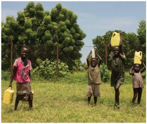 Access to water for drinking, cooking, washing and other daily needs has become increasingly unequal. These children, in South Sudan, must transport it for their families. (Photo: UN photo)
