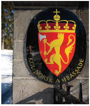 The Norwegian coat of arms is on the roadside gate at the residence. (Photo: Ashley Fraser)