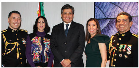 On the occasion of the 105th anniversary of the Mexican air force and the 107th anniversary of the Mexican army's military representation in Canada, officials hosted a reception at the Hilton Garden Inn. From left: Col. Jose Antonio Gomez, Mexican military and air attaché; his wife, Erika; Mexican Ambassador Juan Jose Gomez Camacho; Roxana Reyes and her husband, Col. Roberto Carlos Sanchez, Mexican deputy military and air attaché. (Photo: Ülle Baum)