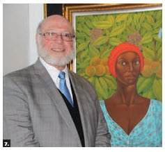 The Embassy of the Dominican Republic and its Cultural Heritage Foundation hosted an art exhibition at Ottawa City Hall. Dominican Ambassador Pedro Luciano Verges Ciman is shown here, with one of the paintings. (Photo: Ülle Baum)