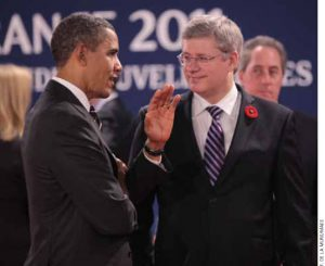 U.S. President Barack Obama and Prime Minister Stephen Harper converse at the G20 Summit in Cannes, France, in November.