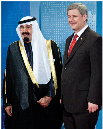 Prime Minister Stephen Harper greets King Abdullah bin Abdulaziz at an official dinner at the G20 Summit in Toronto.