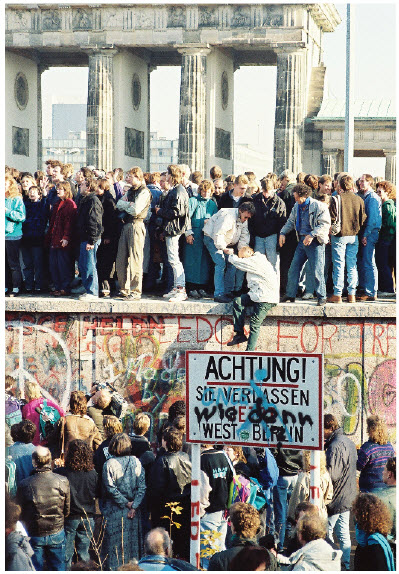 Germans crowd on top of the Berlin Wall, near the Brandenburg Gate in November 1989, the month the wall came down.