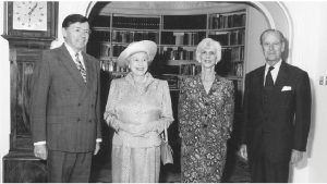 "Roy MacLaren, left, with Queen Elizabeth, his wife Lee, and Prince Philip at the Canadian high commissioner's residence in London. This photo was taken before a luncheon at which the MacLarens' dog, Fergus, paid the queen ""special attentions."""