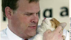 Mr. Baird at the opening of the Ottawa Humane Society's new facility with Chance the cat.
