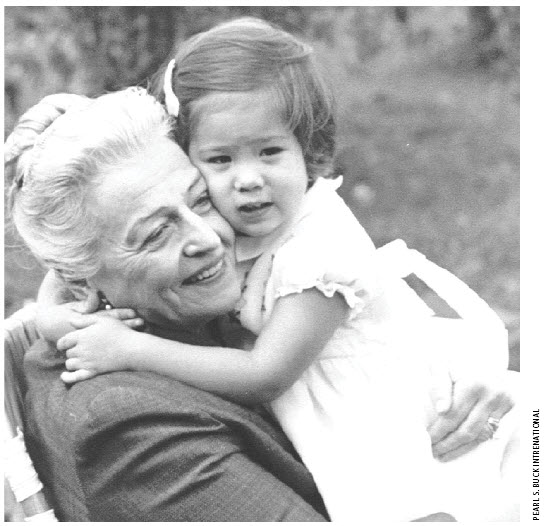 Pearl S. Buck, in the 1960s, hugging one of the children helped by Pearl S. Buck International