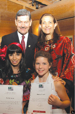 To mark Mexico's national day, Ambassador Francisco J. Barrio and his wife, Hortensia, hosted a reception at the Canadian Museum of Civilization. The Barrios are shown with 12-year-old Yamin Naemi, who sang the Mexican national anthem, and Madison Pimentel, 11, who sang O Canada. (Photo: Jennifer Campbell)