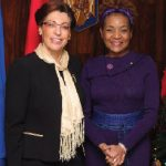 Romanian Ambassador Elena Stefoi hosted a national day reception Dec. 1 at her embassy. She's shown here with former Gov. Gen. Michaelle Jean. (Photo: Sam Garcia)