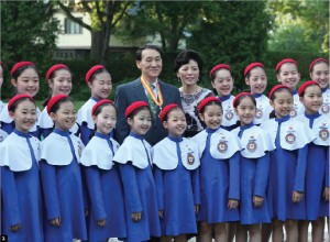 Korean Ambassador Chan-Ho Ha, and his wife, Young Shin Kim, both centre, back row, hosted a reception June 18, for members of the Little Angels folk ballet, who were in town to perform at the National Arts Centre in June as part of a tour to honour all UN Korean War Veterans. (Photo: Embassy of Korea)