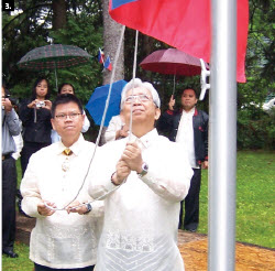 Jose S. Brillantes, ambassador of the Philippines, raises the flag at the 112th Anniversary of Philippine Independence on June 12 with the help of Joseph Angeles, minister and consul.